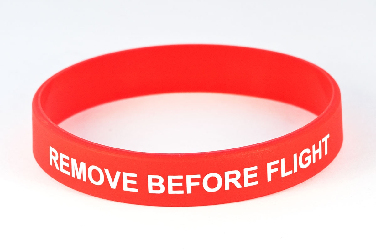 Silicon wristlet Remove before flight